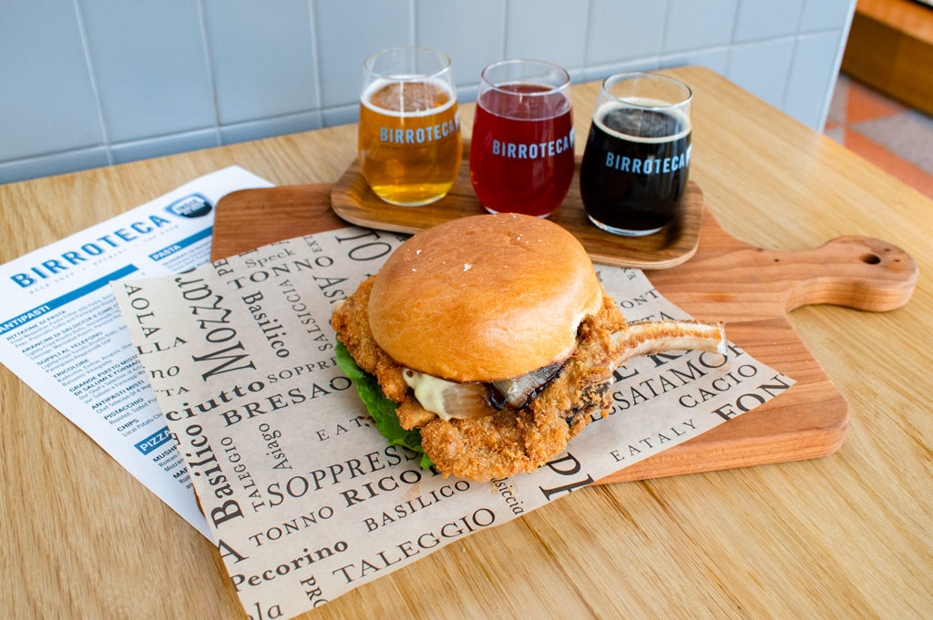 Flight of Birroteca by Indie Alehouse beer with an Eataly pork chop sandwich