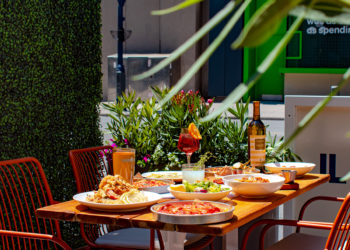 Table of food at Il Patio di Eataly with Aperol