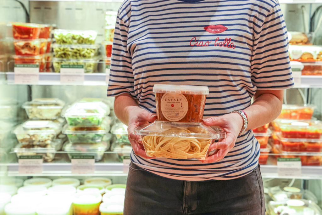 Person holding Eataly housemade sauce and fresh pasta
