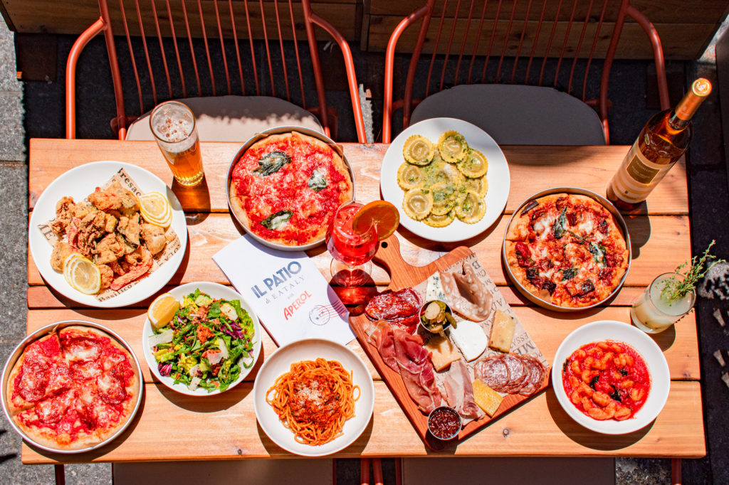 Italian food outdoors at Il Patio di Eataly with Aperol