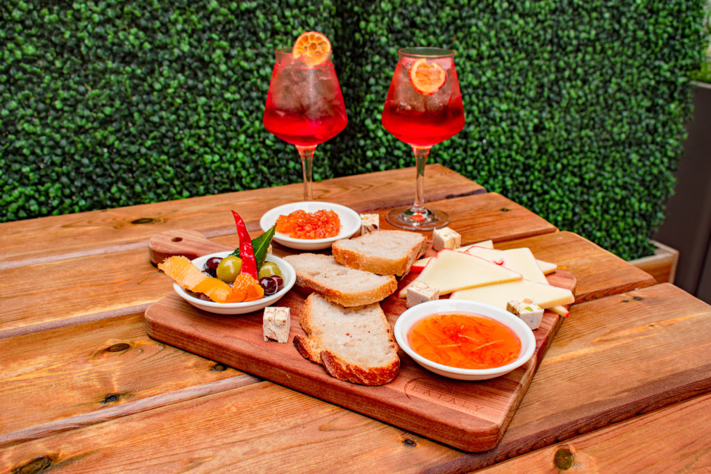 Eataly and Cheese Boutique cheese board at Il Patio di Eataly with Aperol