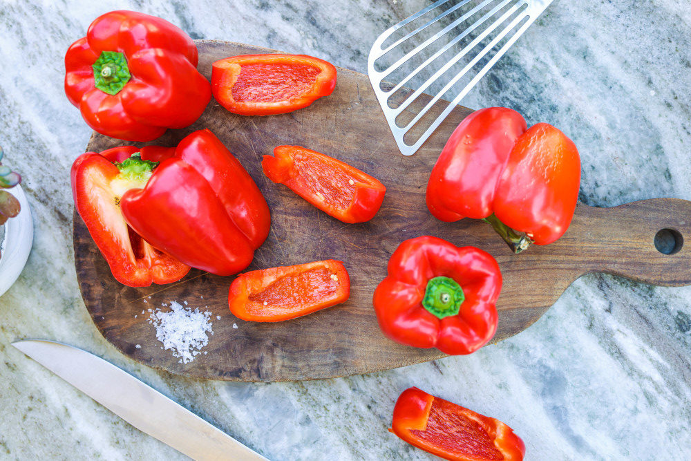 Red peppers on a cutting board