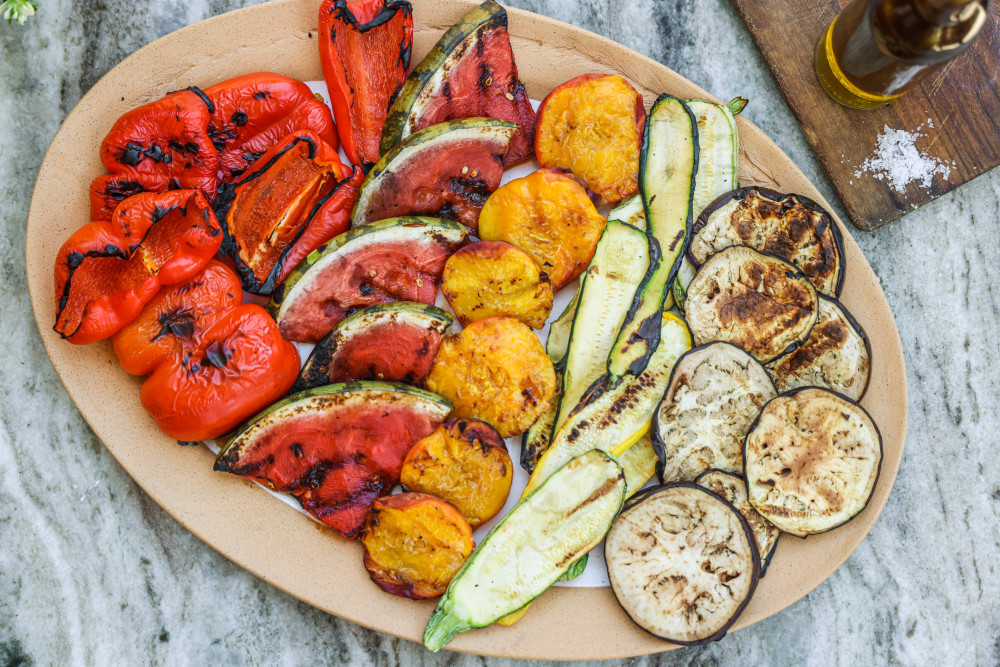 Assortment of grilled produce on a platter