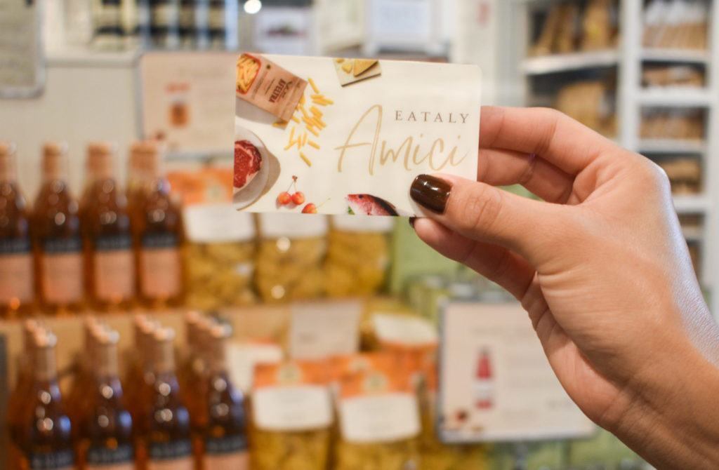 Person holding Eataly Amici card