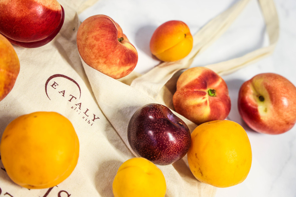 Stone fruit with an Eataly bag