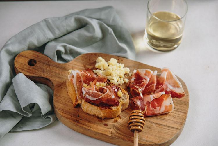 Crostini with Stelvio DOP, Speck Alto Adige IGP, and honey