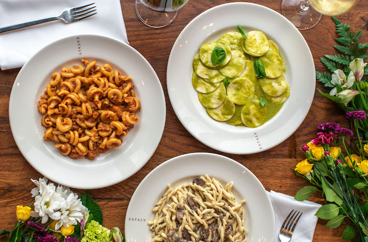 Bowls of cooked pasta on a table