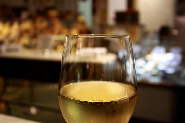 White wine in an Eataly glass